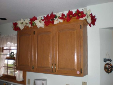 Poinsettas above Kitchen Cabinets