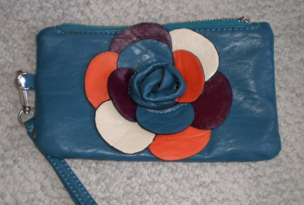 Wristlet Clutch, hand-painted, Flower Petals glossed. Never been used, slight color imperfections on the back, detachable wristlet strap, key fob inside, 1 pocket inside. Size approx 7 inches long, 4 inches high.  $15